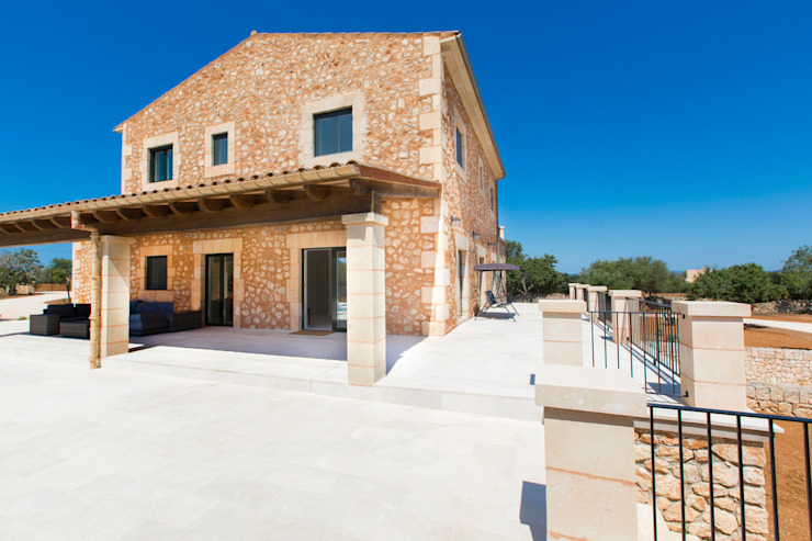 Rustic style house by ISLABAU constructora Rustic
