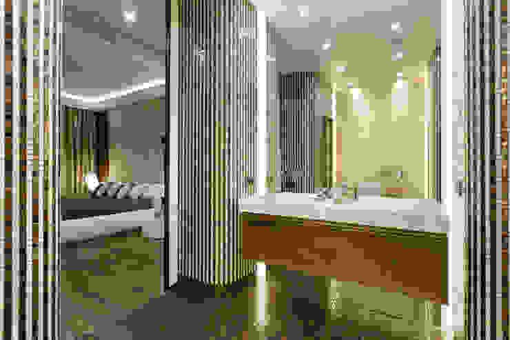 Casas de banho ecléticas por Студия дизайна интерьера 'Юдин и Новиков' Eclético