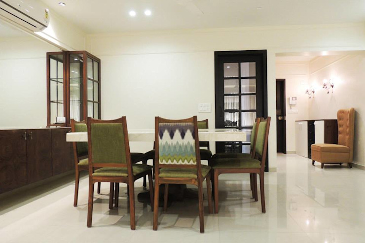 A project at Borivali:  Dining room by SwitchOver Studio