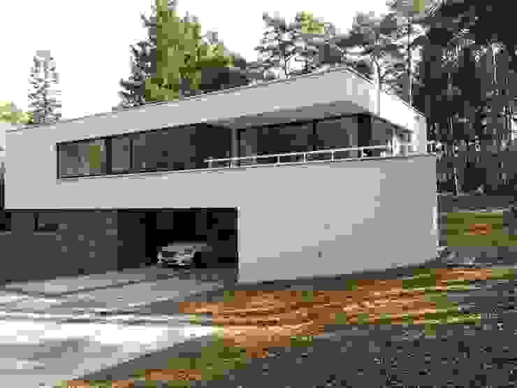 Villa in Ommen Moderne huizen van ir. G. van der Veen Architect BNA Modern