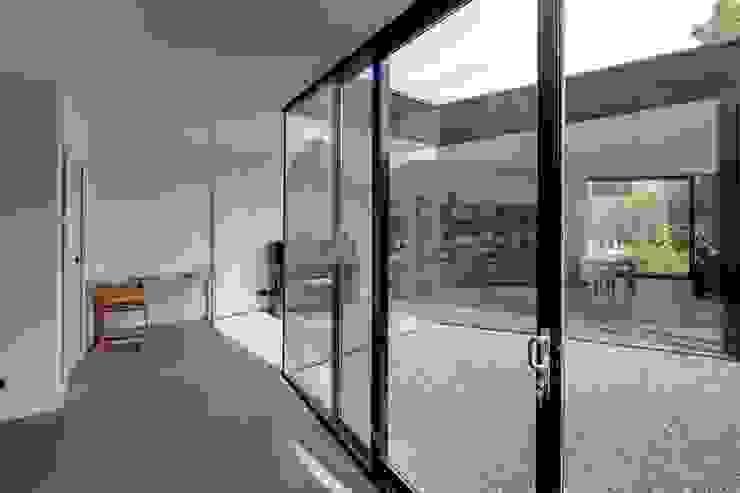 uitbreiding woonhuis Moderne serres van JMW architecten Modern Glas