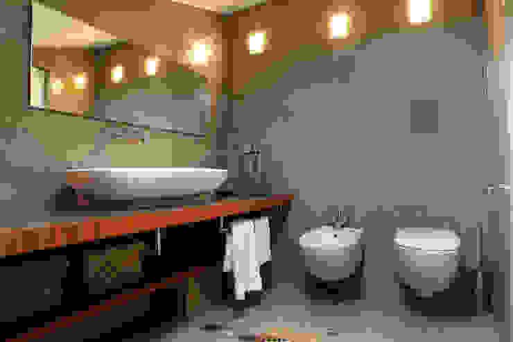 Casas de banho  por studio ferlazzo natoli, Minimalista