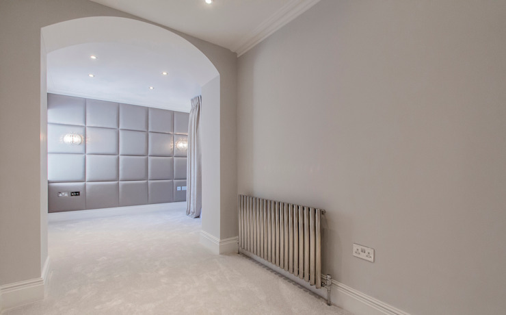 Upholstered padded panels with fitted lights and sockets Dormitorios modernos: Ideas, imágenes y decoración de Mille Couleurs London Moderno