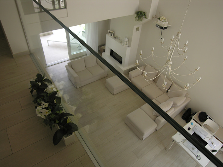 Salas de estilo  por Studio di Architettura e Ingegneria Brasina-Rubino, Moderno