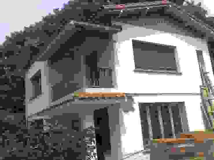 Klassische Häuser von ReformArq - Casas, reformas y ampliaciones Klassisch Ziegel