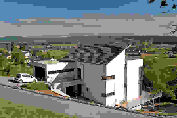 Houses by Hauptvogel & Schütt Planungsgruppe, Modern
