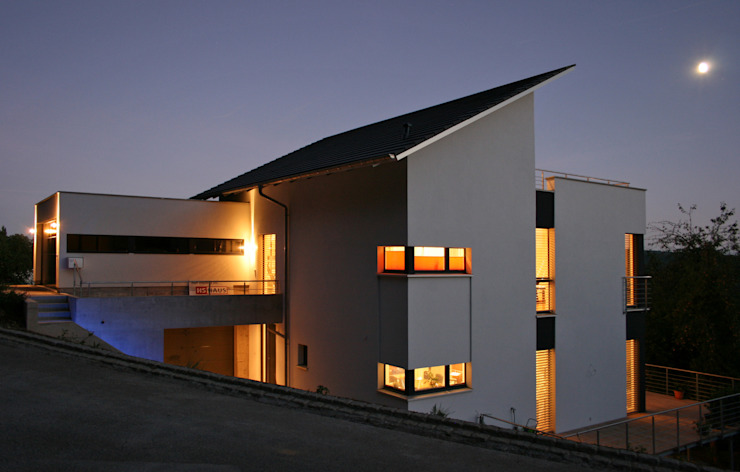 Maisons de style  par Hauptvogel & Schütt Planungsgruppe, Moderne