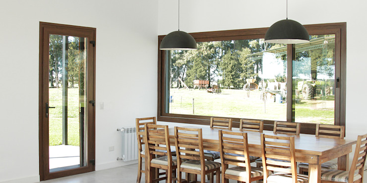 Dining room by BAM! arquitectura, Country
