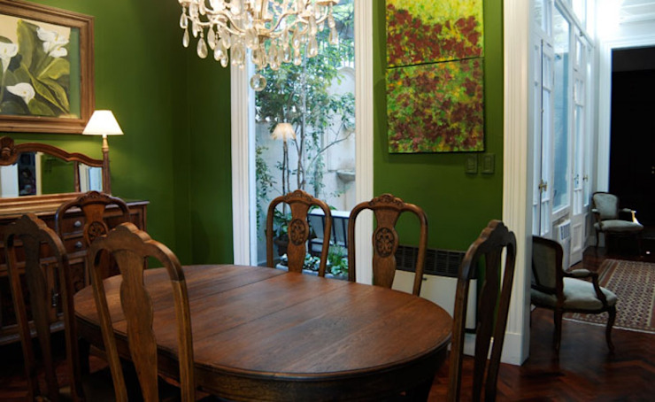 Sala comedor. Radrizzani Rioja Arquitectos Salle à manger originale Béton Vert
