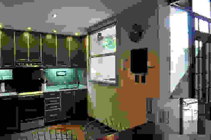 Cocina + sala comedor Cocinas de estilo minimalista de Radrizzani Rioja Arquitectos Minimalista Tablero DM