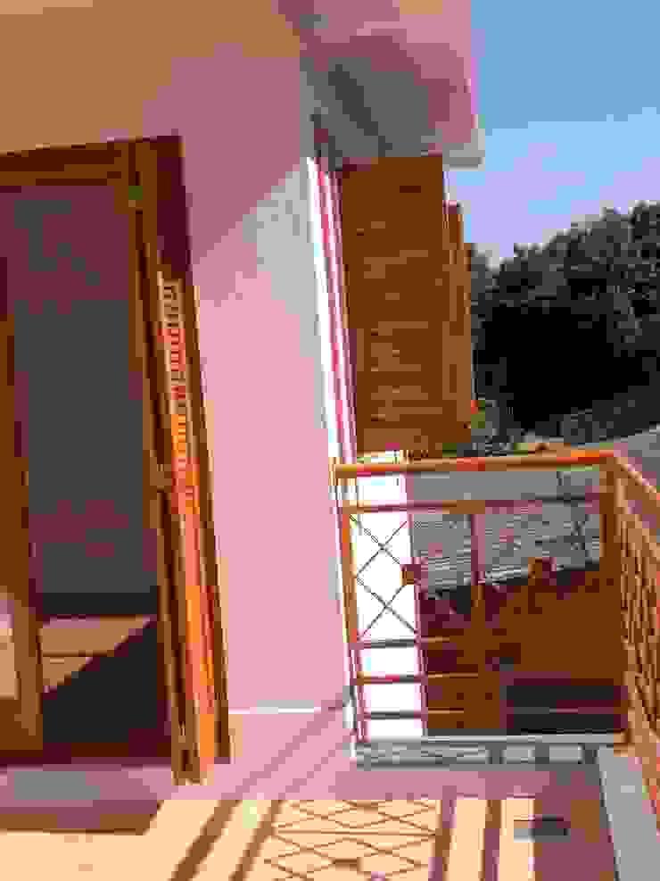 Terraço Varandas, alpendres e terraços modernos por Graziela Alessio Arquitetura Moderno Metal