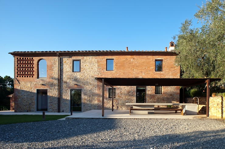 Rustic style house by MIDE architetti Rustic