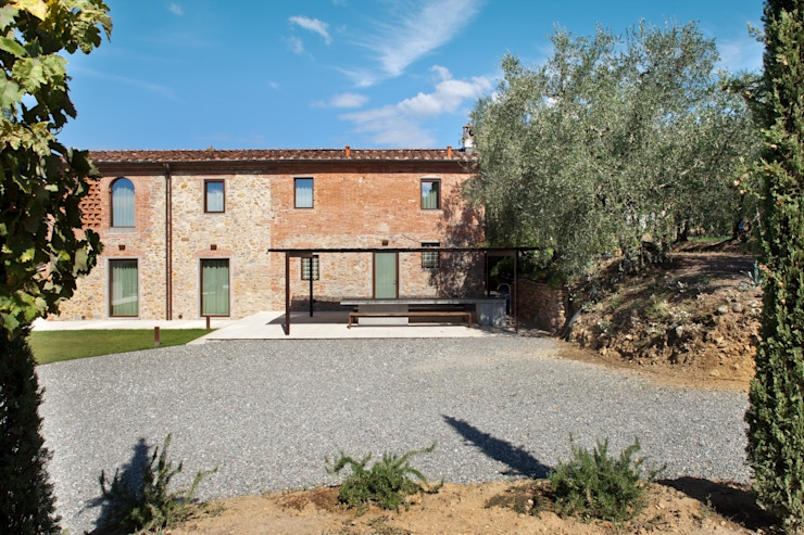 MIDE architetti Rustic style house