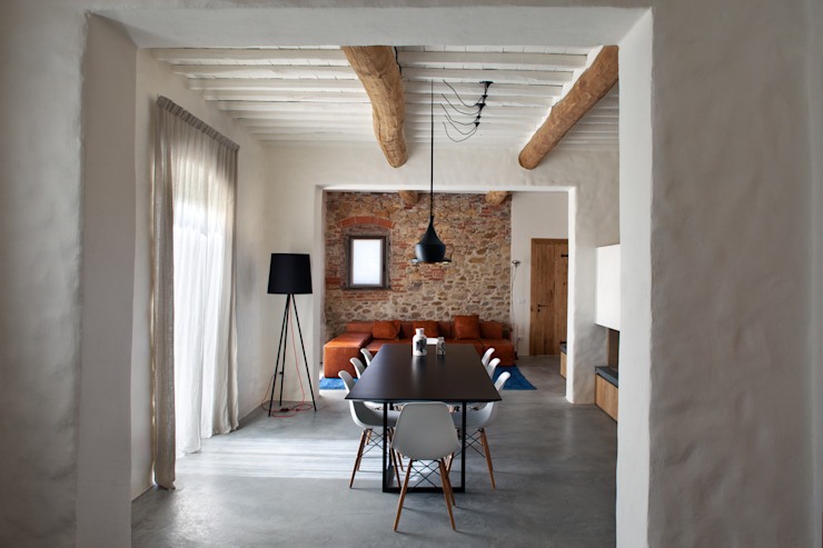 Rustic style living room by MIDE architetti Rustic