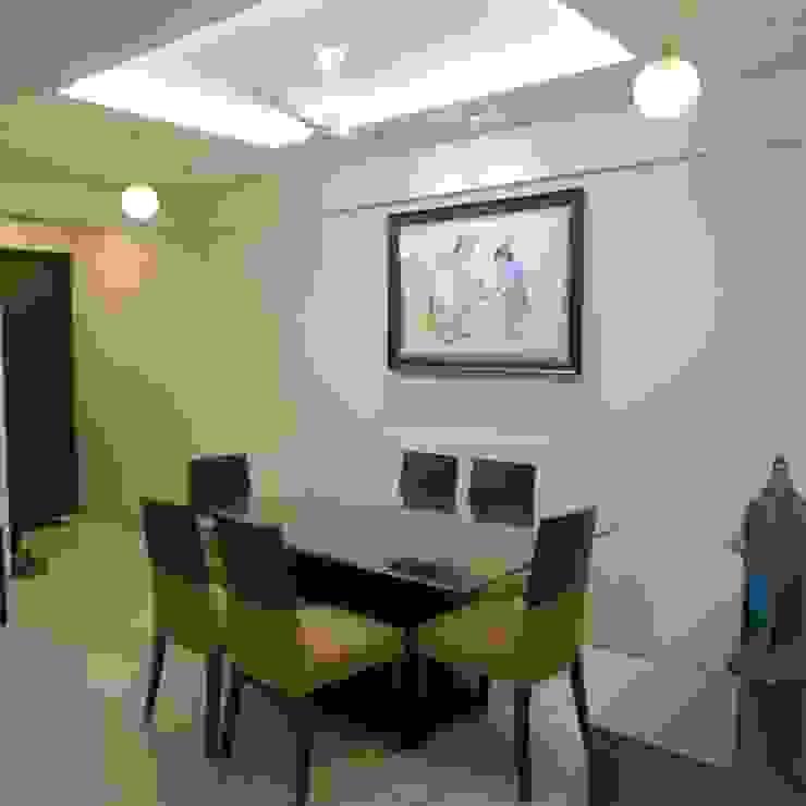 Minimalist dining room by TWISHA THAKKER Minimalist