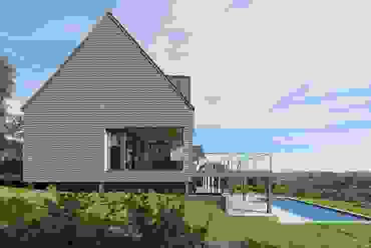 Transformation de la villa E: Maisons de style  par BURO5 - architectes & associés