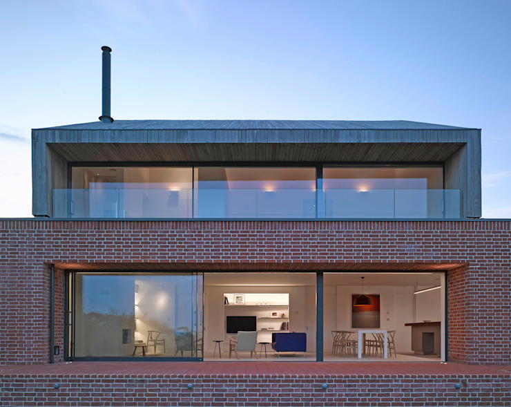 Rear elevation of the house at Broad Street in Suffolk Modern houses by Nash Baker Architects Ltd Modern Bricks