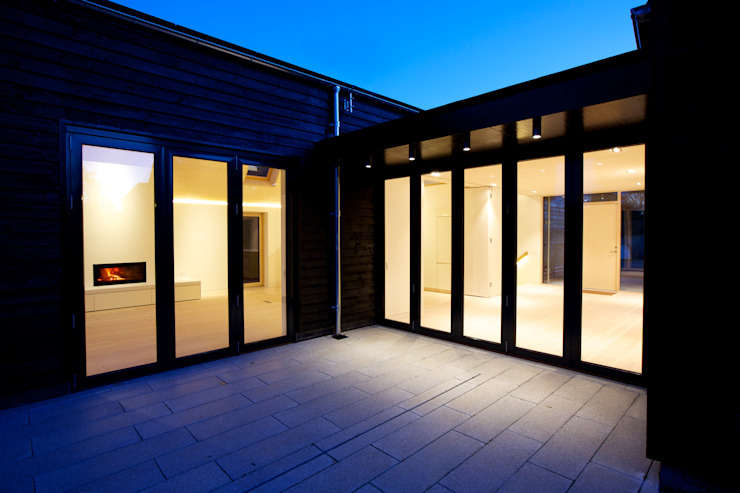 Rear entrance of ​Bourne Lane eco-house in Kent at twilight Modern houses by Nash Baker Architects Ltd Modern Wood Wood effect