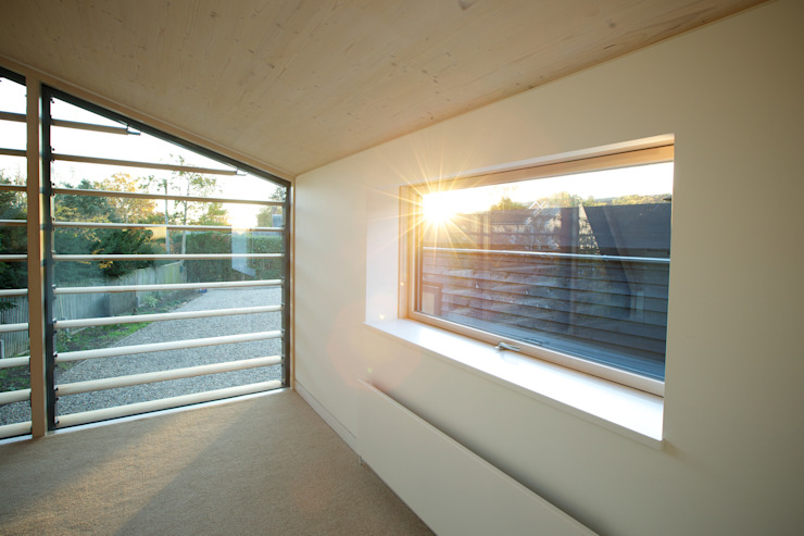 Upstairs bedroom at the Bourne Lane Eco House. Modern style bedroom by Nash Baker Architects Ltd Modern