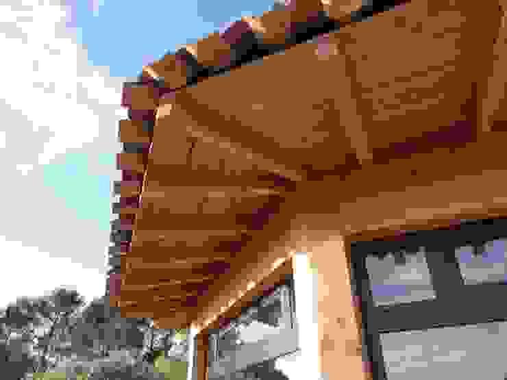 Une véranda panoramique à Puget/Argens par Agence TRIHAB