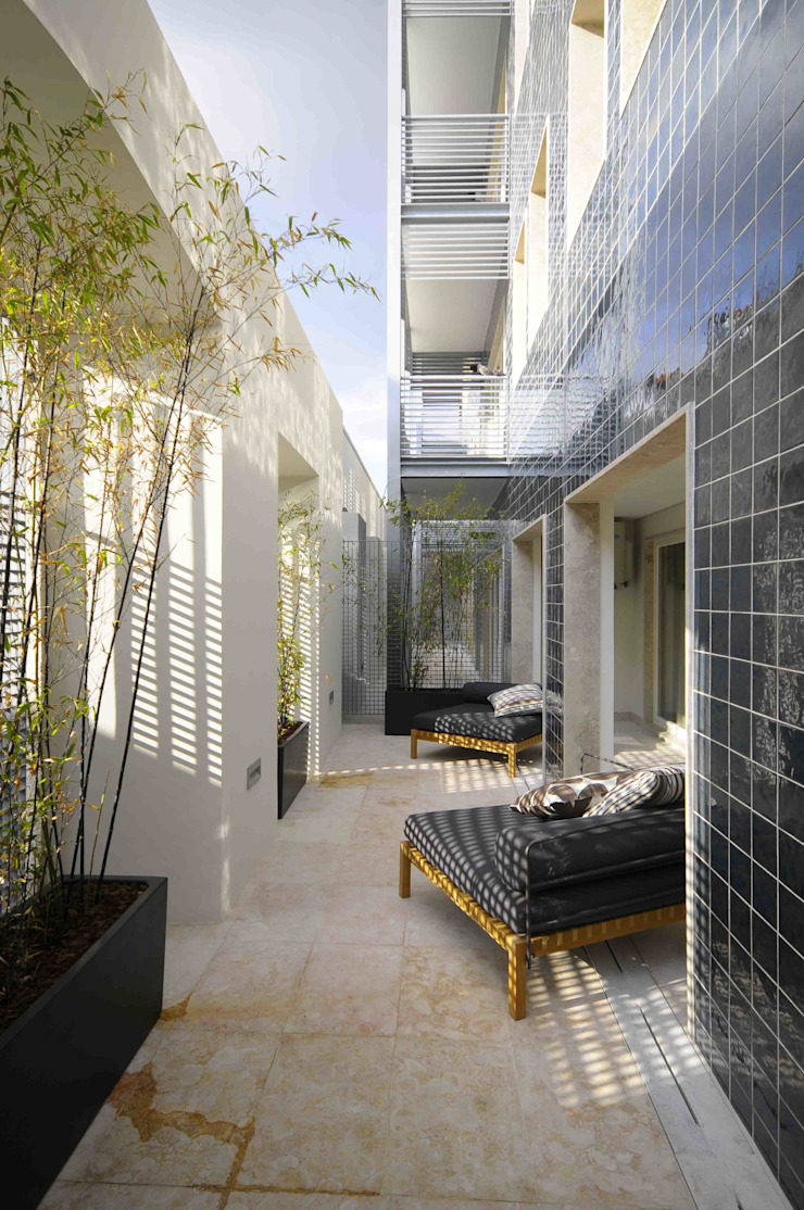 Exterior Varandas, alpendres e terraços modernos por armazem de arquitectura Moderno
