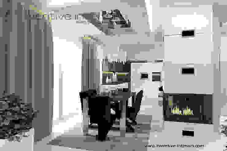 INVENTIVE INTERIORS – Klimatyczny dom w szarościach Nowoczesna jadalnia od Inventive Interiors Nowoczesny