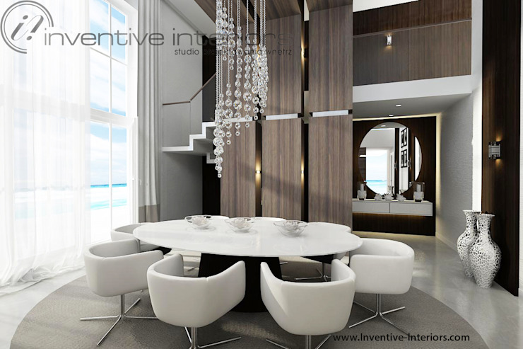 Owalny stół w wysokiej jadalni Nowoczesna jadalnia od Inventive Interiors Nowoczesny Drewno O efekcie drewna