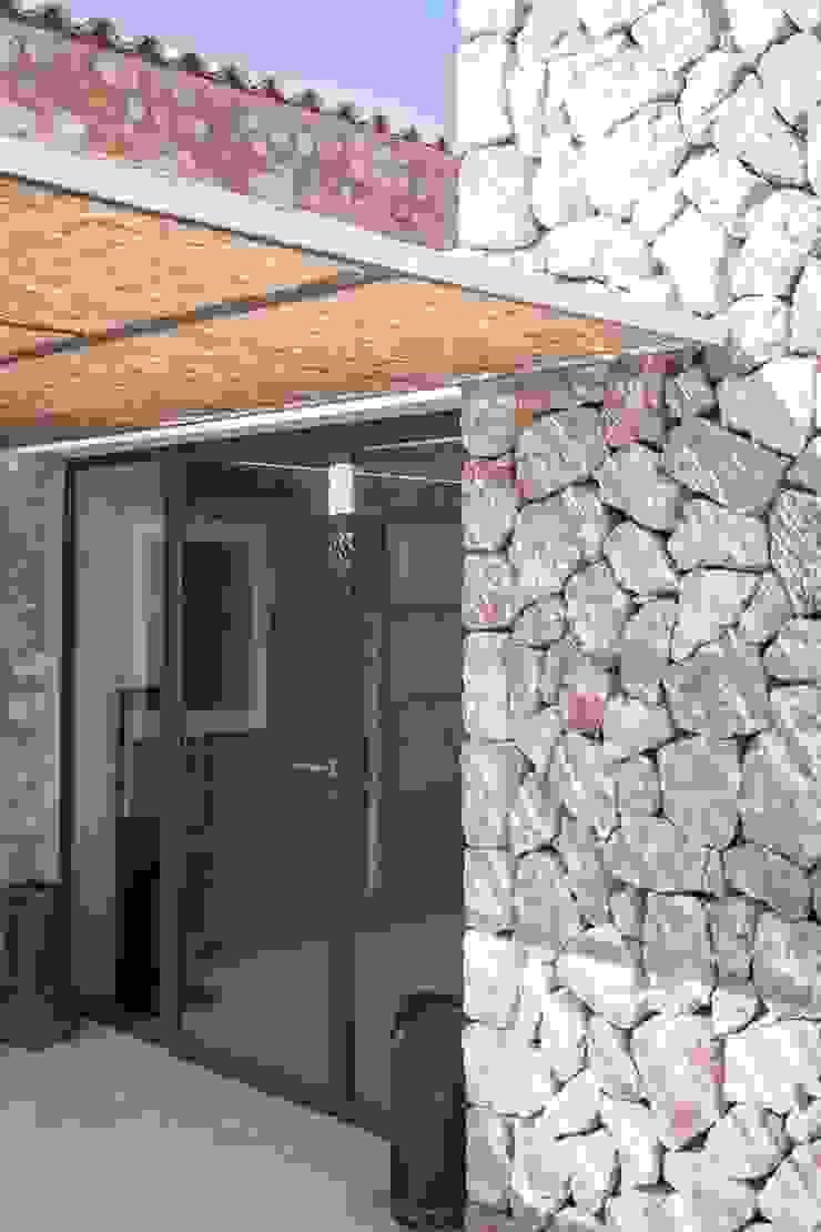 CAN VALLS Casas de estilo rústico de munarq Rústico