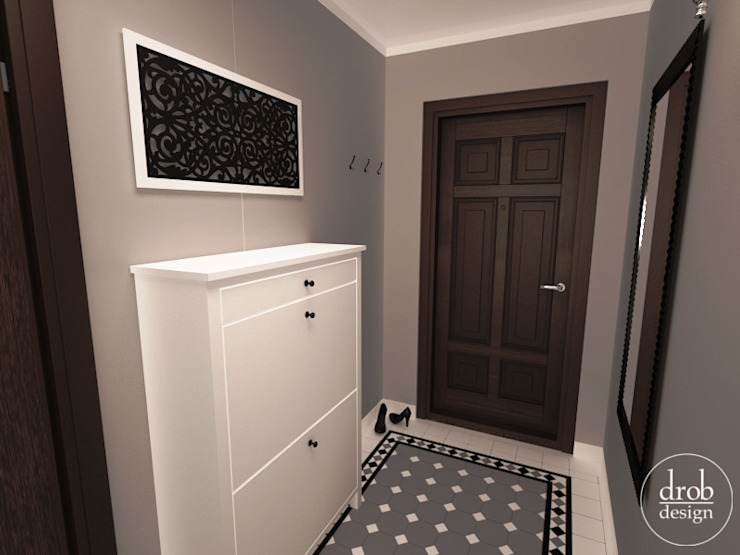 Klasyczny Holl - mieszkanie w Lublinie. Widok na szafkę na buty. Klasyczny korytarz, przedpokój i schody od Drob Design Klasyczny Ceramiczny