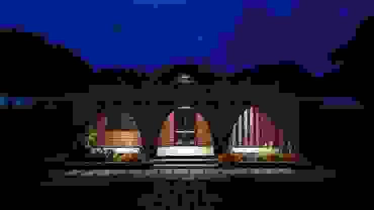 eco-friendly bunglow by Ar.Ankit Kankariya Country style balcony, veranda & terrace by Kankariya Developers Country Bricks