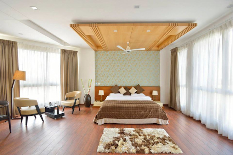 J. P. GREENS FLAT Modern style bedroom by Spaces Architects@ka Modern