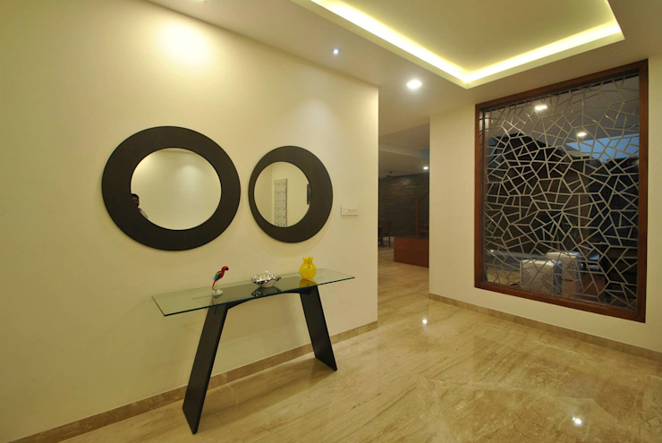 Modern walls & floors by Murali architects Modern