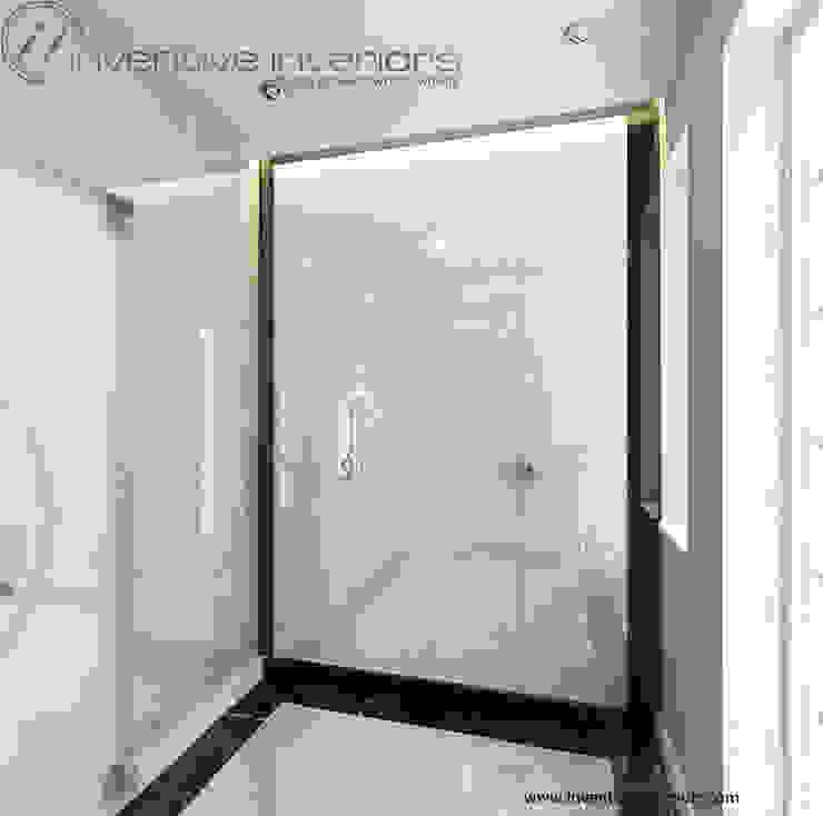 Piękny wiatrołap Nowoczesny korytarz, przedpokój i schody od Inventive Interiors Nowoczesny Marmur