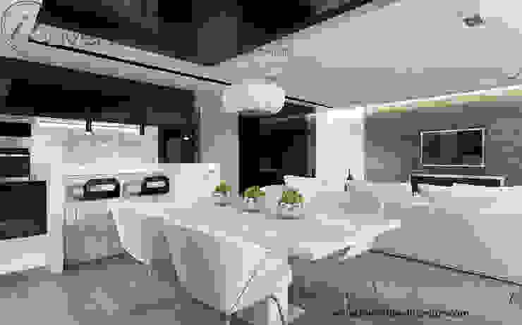 Biały stół, białe krzesła i czarny sufit w jadalni Nowoczesna jadalnia od Inventive Interiors Nowoczesny