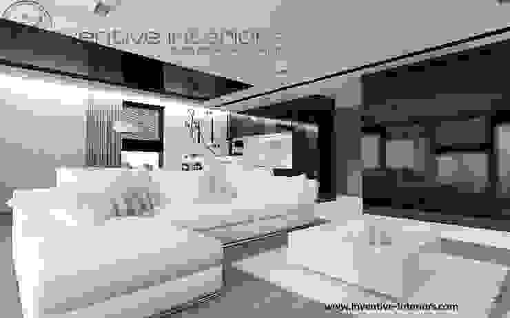 Nowoczesny salon: biel, czerń i drewno Nowoczesny salon od Inventive Interiors Nowoczesny Drewno O efekcie drewna
