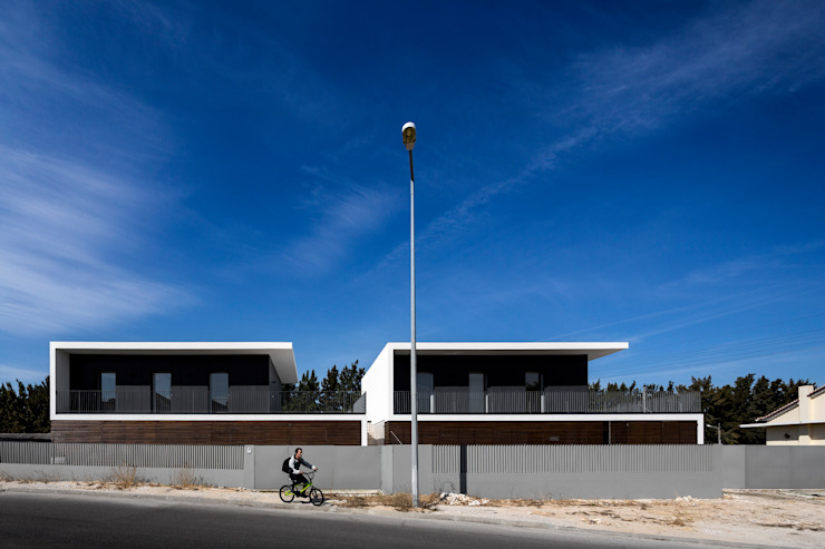 FACHADA PRINCIPAL por OW ARQUITECTOS lda | simplicity works Moderno