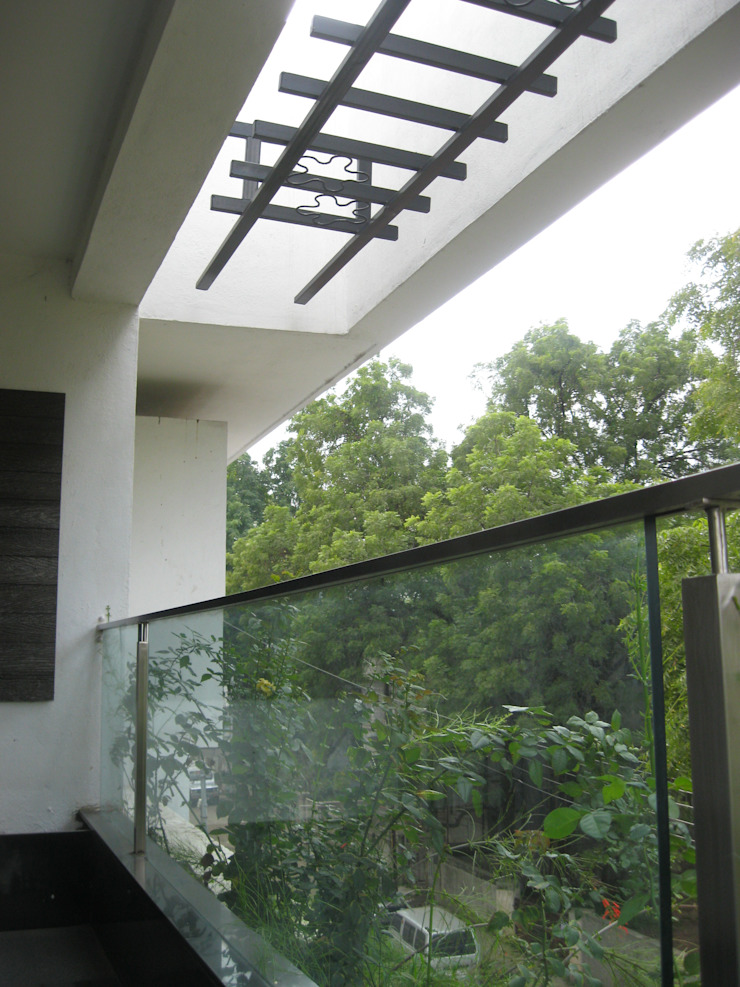 Asian style balcony, veranda & terrace by ar.dhananjay pund architects & designers Asian