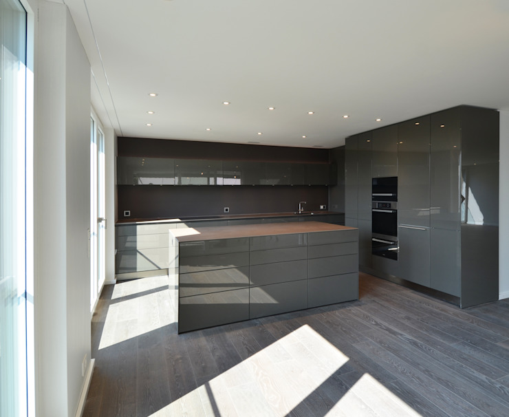 Cozinhas modernas por Fröhlich Architektur AG Moderno