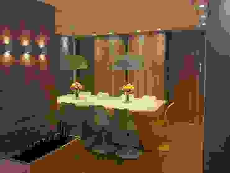 Sala de jantar com espelho por Palloma Meneghello Arquitetura e Interiores Moderno MDF