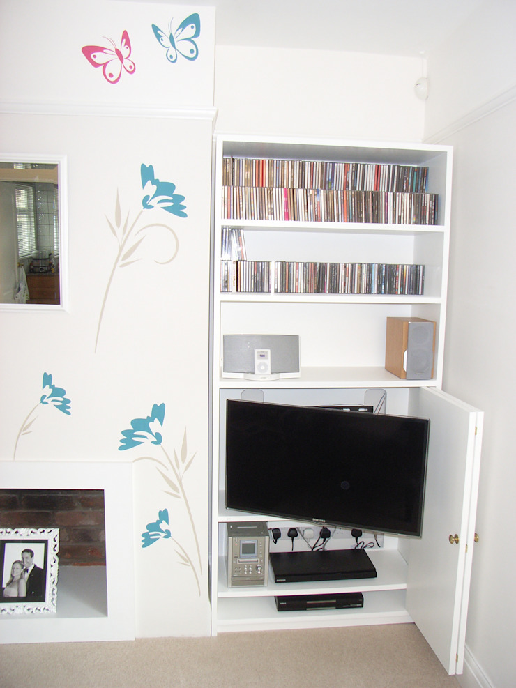 TV hidden in alcove unit Style Within Salones modernos