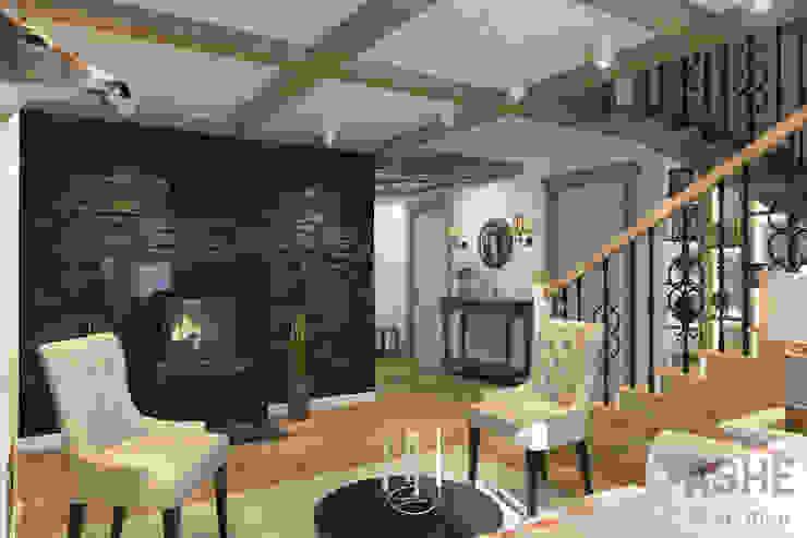 Загородный дом с стиле шале Гостиная в рустикальном стиле от Студия авторского дизайна ASHE Home Рустикальный