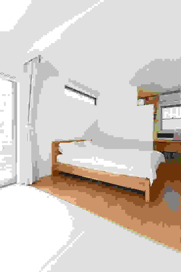 リビングとテラスがつながる家 モダンスタイルの寝室 の 福島工務店株式会社 モダン