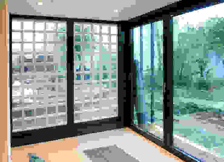 Olivier Stadler Architecte Modern balcony, veranda & terrace Aluminium/Zinc Transparent