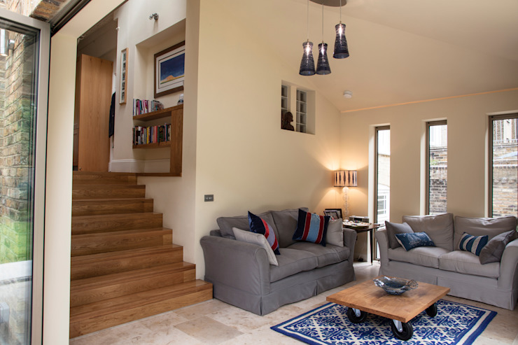 Clapham home Classic style living room by Warren Rosing Architects Classic Stone