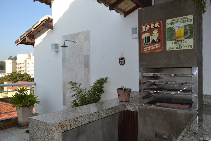 churrasqueira gourmet Varandas, alpendres e terraços modernos por Isabella Machado Arquitetura Moderno
