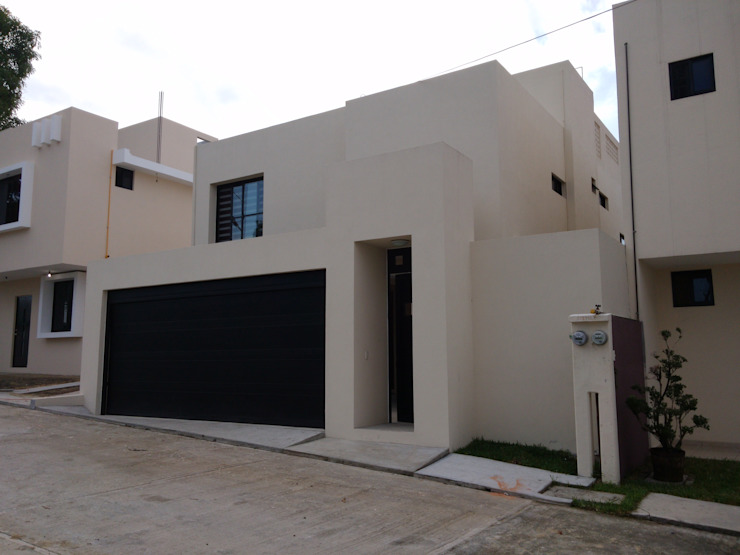 Constructora e Inmobiliaria Catarsis Casas de estilo minimalista Ladrillos Beige
