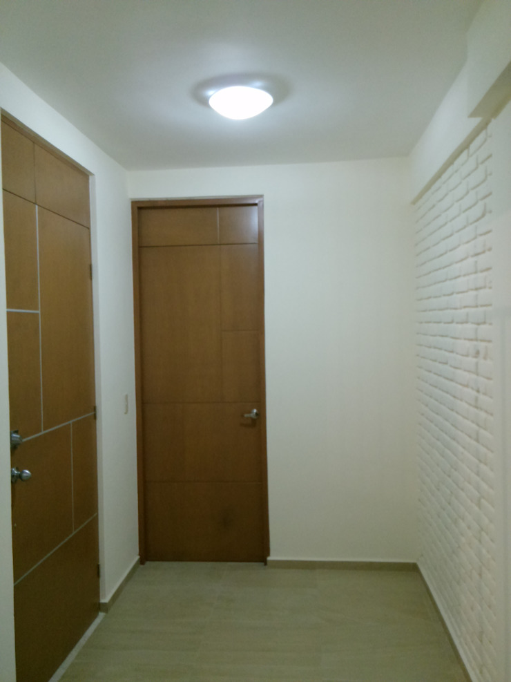 Casa Sta.Elena Pasillos, vestíbulos y escaleras minimalistas de Constructora e Inmobiliaria Catarsis Minimalista Ladrillos
