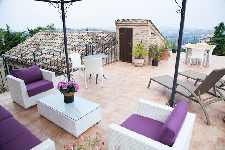 Terrace by Ing. Vitale Grisostomi Travaglini, Rustic