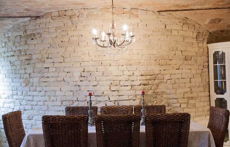 Rustic style dining room by Ing. Vitale Grisostomi Travaglini Rustic