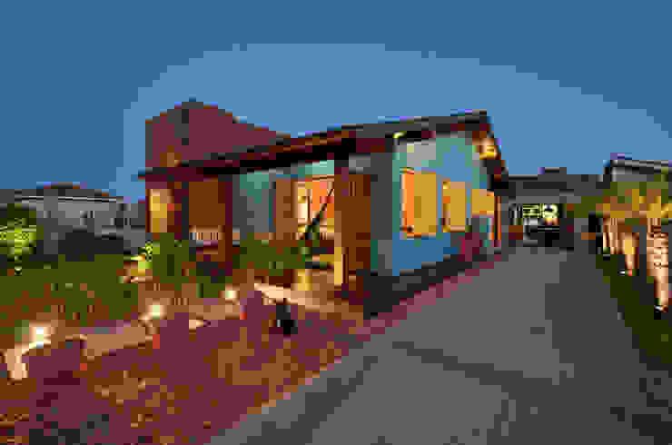Casas de estilo tropical de Arquitetando ideias Tropical